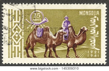 MOSCOW RUSSIA - CIRCA AUGUST 2016: a stamp printed in MONGOLIA shows a postman on Bactrian Camel (Camelus bactrianus) the series