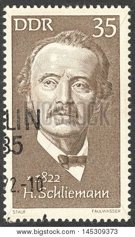 MOSCOW RUSSIA - CIRCA AUGUST 2016: a stamp printed in DDR shows a portrait of Heinrich Schliemann the series