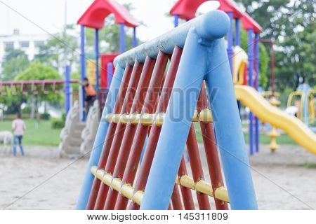 Public playground with red adnd blue plaything