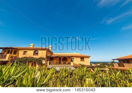 luxury houses under a clear sky in Costa Smeralda Sardinia