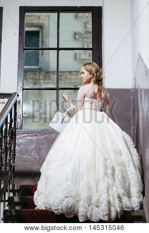 Small Girl In White Dress Near Big Window