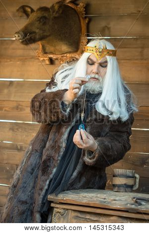 Old Wizard With Stone And Pendant For Hypnosis