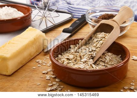 ingredients to bake scottish oatmeal biscuits butter flour oatmeal