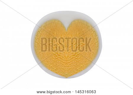 Boiled Chicken egg with heart shaped egg yolk, isolated on white background