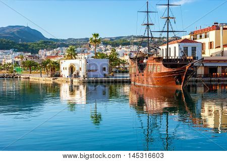 The pirate galleon in old harbor of Rethymno offers the great adventure to the tourists would dare to make a trip on it Crete Greece.