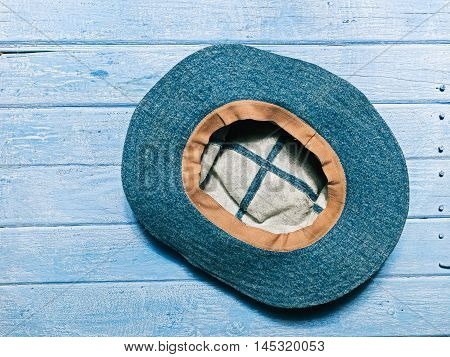 Jeans summer hat on the planked footway. Flat lay