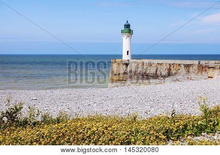 Saint-Valery-en-Caux Lighthouse and the beach. Saint-Valery-en-Caux Normandy France