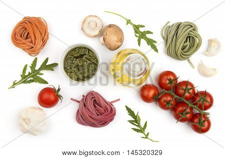 Colorful hand-made pasta and ingredients: vegetables and oil top view. Italian healthy food cooking.