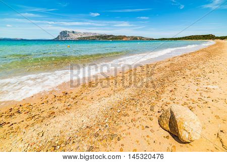 orange pebbles in Capo Coda Cavallo shore Sardinia