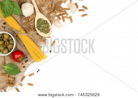 Wholegrain pasta and other ingredients on a rustic cloth. Healthy food background with copy-space.