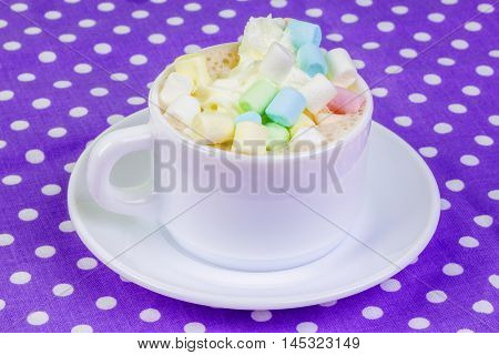 Cup of cappuccino with marshmallows in backgrounds