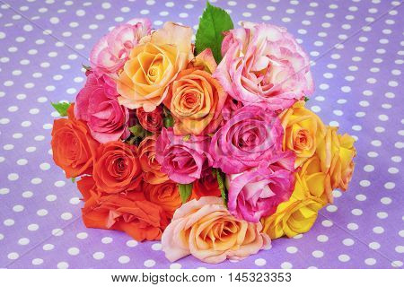 Rose bouquet of different colors on the table