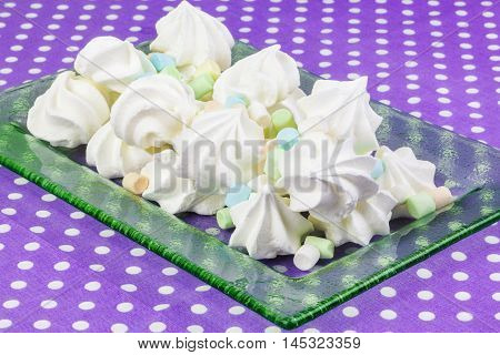 Meringue cookies with marshmallows in backgrounds .