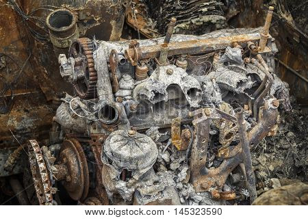 Burned down rusty engine in summer day