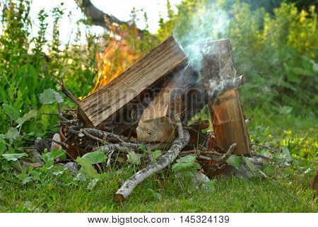 A Flaming Camp Fire in Early Autumn