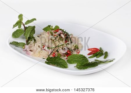 Spicy pamelo pulp salad on white background.