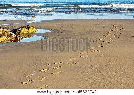 Footprints In The Sand On Polzeath Beach