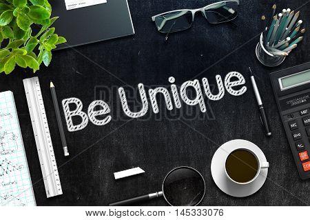 Be Unique Concept on Black Chalkboard. 3d Rendering. Toned Image.