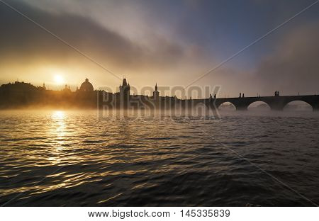 Beautiful Misty Towers Of Charles Bridge And Old Town District With Reflection At Vltava River Durin