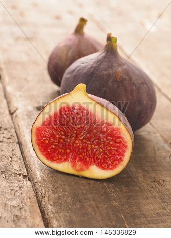 Fresh organic figs on a rustic wooden table in a kitchen