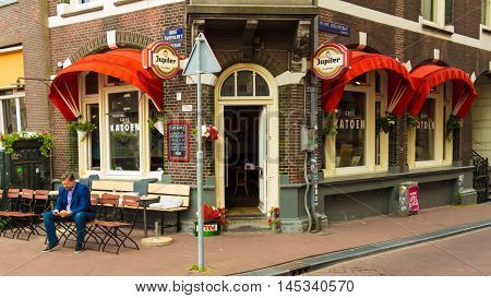 Amsterdam the Netherlands-July 27 2016: The traditional Dutch cafe Katoen located at Turfmarkt in Amsterdam the Netherlands.