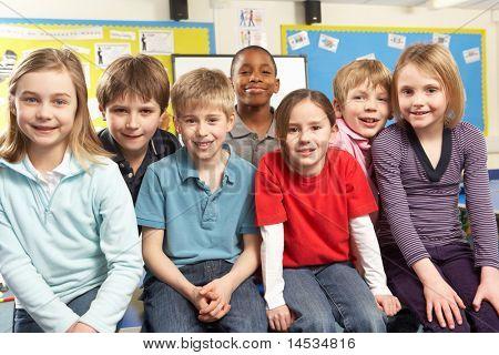 School Children In Classroom Smiling