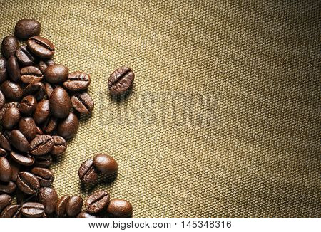 Fresh coffee beans on the basis of goods background
