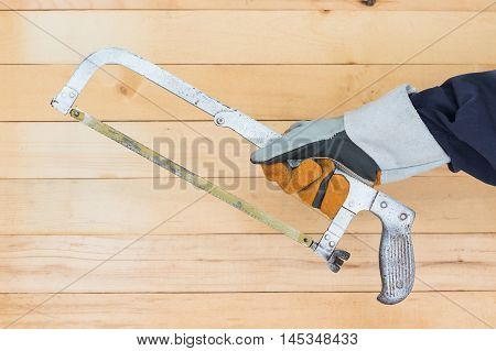 Hand In Glove Holding Hack Saw