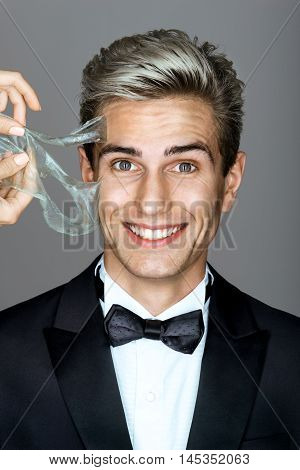 Happy gentleman having pore cleaning procedure in parlor. Even men like to be soft...