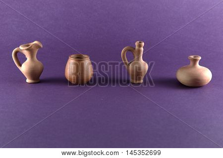 clay pot isolated on lilac background, art design