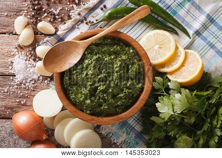 Argentine Chimichurri Sauce With Ingredients Close-up. Horizontal Top View