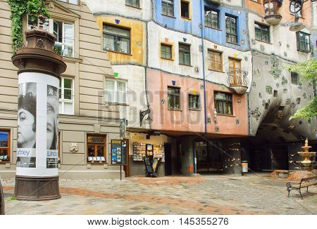 VIENNA, AUSTRIA - JUN 12, 2016: Street with weird structure in concept of Austrian artist Hundertwasser on June 12, 2016. Hundertwasserhaus built at 1985 and became the cultural heritage