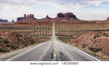 Stunning Scenic view highway road in Utah america. Monument Valley scenic road. Monument Valley long road. Travel route Utah. Forrest Gump Point Utah.