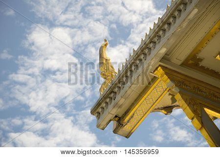 Serpent sculpture of temple roof in Thailand. ornament and detail in Thai art.