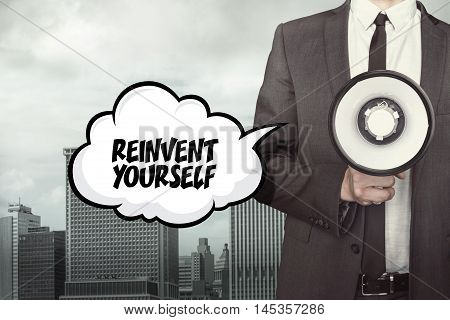 Reinvent yourself text on speech bubble with businessman holding megaphone