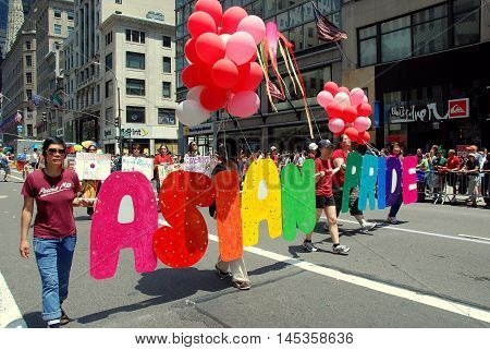 New York City - June 27, 2009: Asian Pride members marching at the 40th anniversary gay pride parade onfifth Avenue