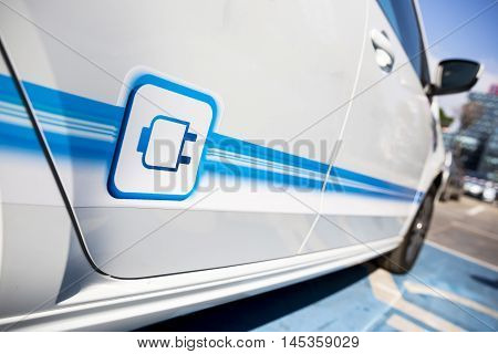 Sofia, Bulgaria - August 29, 2016: Electric Vehicle with a plug in sign on it. An electric car is an automobile that is propelled by one or more electric motors using electrical energy stored in rechargeable batteries.