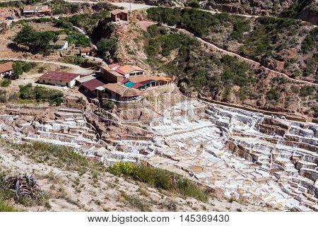 Maras Peru -May 18 : Salt mines in Maras Peru using the sunshine to evaporate the water. May 18 2016 Maras Peru.