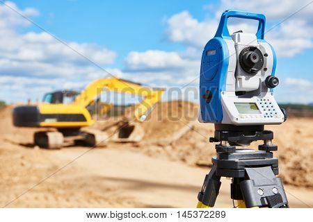 surveyor equipment theodolie at construction site