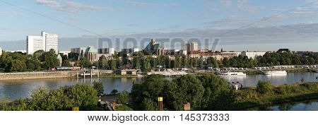 MAGDEBURG, GERMANY - AUGUST 15, 2016: Panorama of the banks of the Elbe River near Magdeburg. The shore is very popular with tourists and residents, because you can do from here excursions with ships.