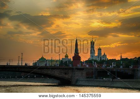 Moscow view Russia. Moscow Kremlin towers at the sunset - Moscow architecture landscape. View of the Moscow Kremlin from the water at summer sunset. Moscow Kremlin in colorful sunset light.
