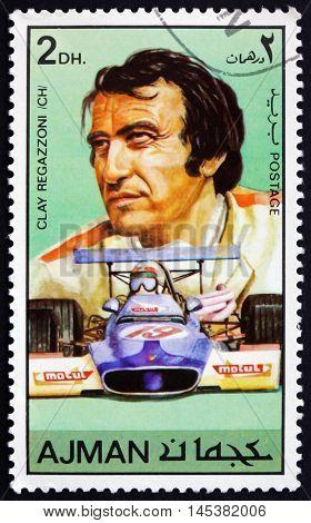AJMAN - CIRCA 1971: a stamp printed in Ajman shows Gian-Claudio Giuseppe Clay Regazzoni Swiss Racing Car Driver circa 1971