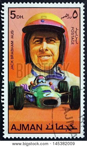 AJMAN - CIRCA 1971: a stamp printed in Ajman shows Sir Jack Brabham Australian Racing Car Driver circa 1971