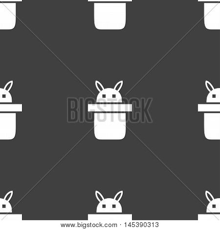 Magician Hat. Rabbit Ears Icon Sign. Seamless Pattern On A Gray Background. Vector