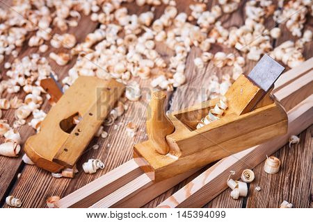 Wooden planer, natural building materials, woodwork and antique hand tools,  tool kit for joinery, wood sawdust
