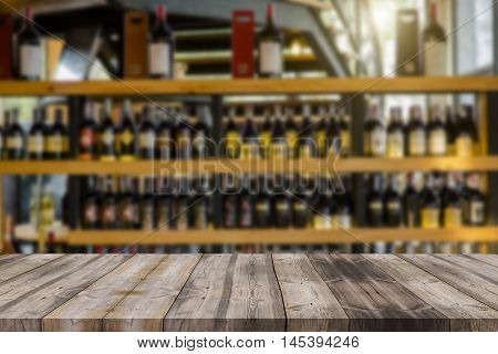 Wood Table And Wine Liquor Bottle On Shelf Blurred Background Can Be Used For Display Or Montage You