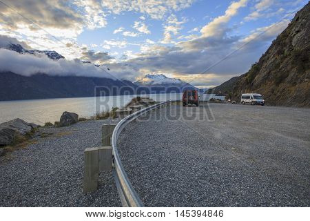 QUEENSTOWN NEW ZEALAND - AUGUST 30 : suv car and camper van on highway of lake wakatipu beautiful scenic and important traveling destination in queenstown on august 30 2015 in Queenstown New Zealand