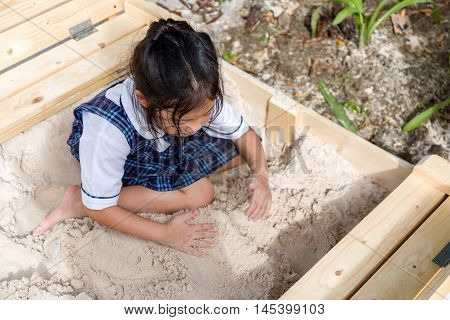 Child Playing Sand In Sandbox