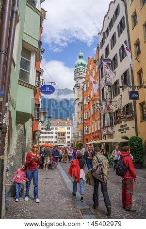 INNSBRUCK, AUSTRIA - August 17, 2010: Turist on street of the center of Innsbruck old town Austria. Innsbruck is the capital city of the federal state of Tyrol (Tirol)