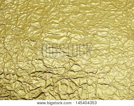 Monotone texture in cold colors of the golden foil.